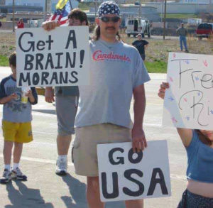 Famous image of man with misspelled sign outside Boeing plant in Charles, Missouri, in 2003.